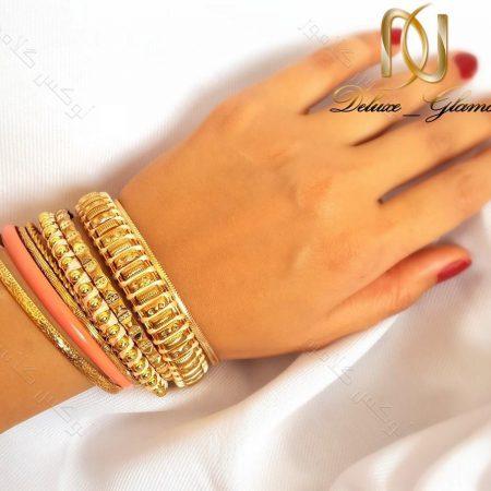 پک هشت تایی النگو هندی طلایی زنانه ds-n107 از بالا روی دست