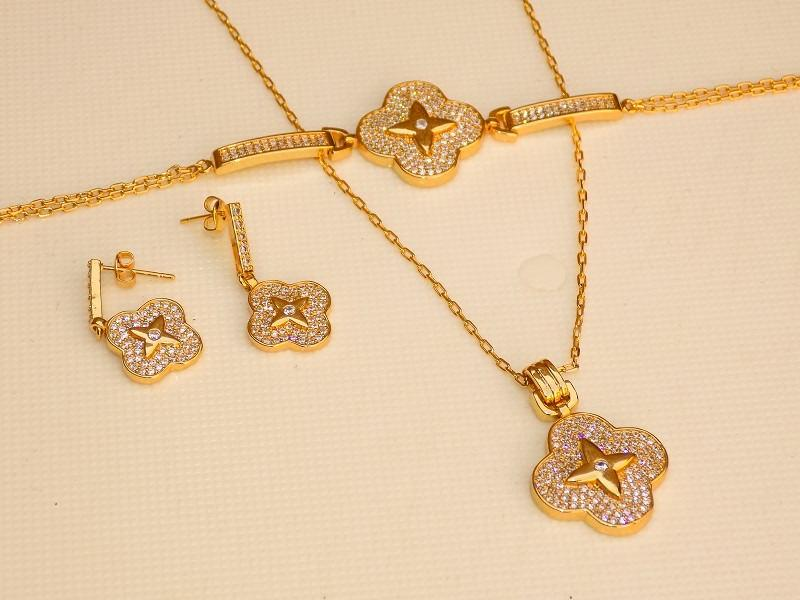 سرویس تمام زنانه نگین دار طرح طلا مدل شکوفه کد SE-n101