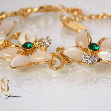 دستبند دخترانه طرح گل طلایی کلیو با المان های سواروسکی ds-n121 از کنار