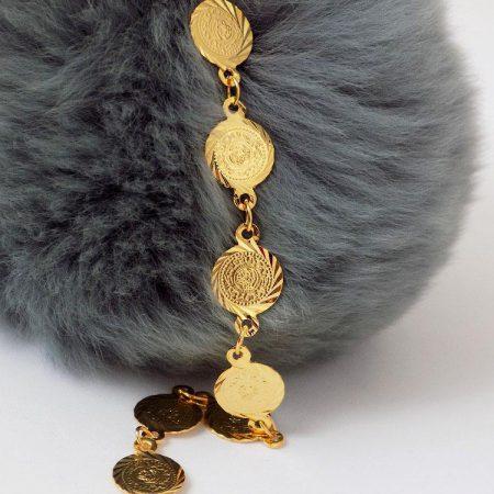 دستبند سکه ای طرح طلا دخترانه - سکه ریز ds-n12 بر روی دکور