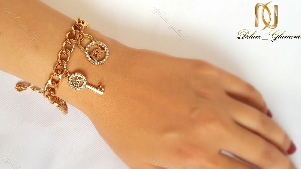 دستبند آویزدار دخترانه طلایی زنجیری DX کد ds-128