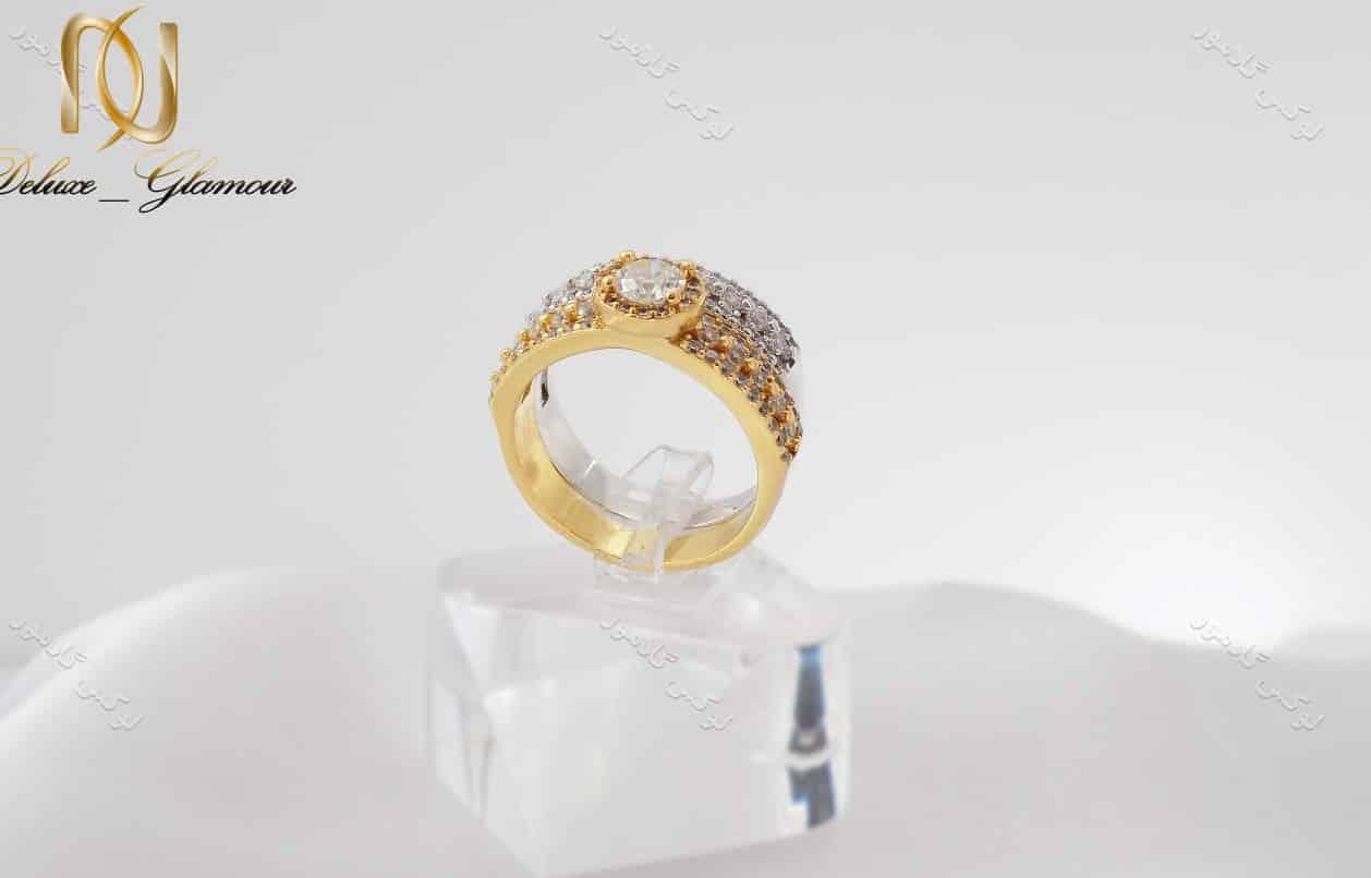 انگشتر و پشت حلقه دخترانه با المان های سواروسکی طلایی و نقره ای rg-n127