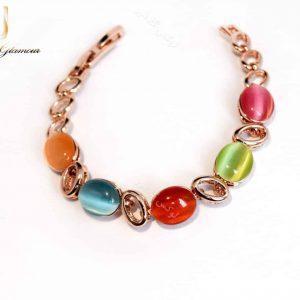 دستبند دخترانه رزگلد و ظریف کلیو با سنگ اپال رنگی ds-n164 از بالا نزدیک