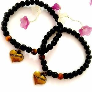 دستبند ست دخترانه و پسرانه قلب سنگ اونيكس مات و سنگ چشم ببري ah-d102 از نمای بالا