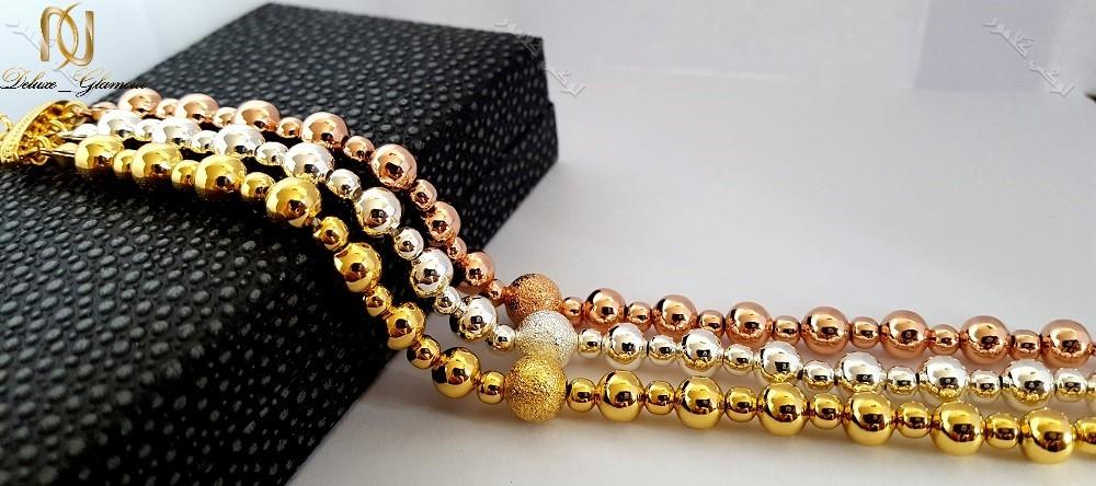دستبند دخترانه سه ردیفه طرح توپی با سه ردیف رزگلد،طلایی و نقره ای کلیو Ds-n168 عکس از نزدیک