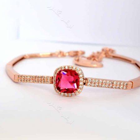 دستبند لوکس دخترانه رزگلد کلیو با کریستال قرمز سواروفسکی اصل Ds-n170