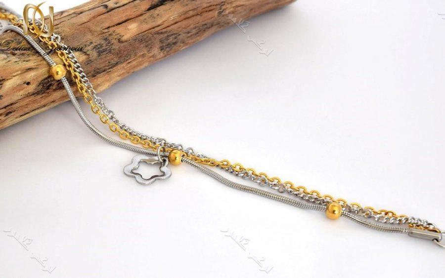 پابند دخترانه استیل طلایی نقره ای سه ردیفه با آویز طرح شکوفه Se-n104 عکس با استند