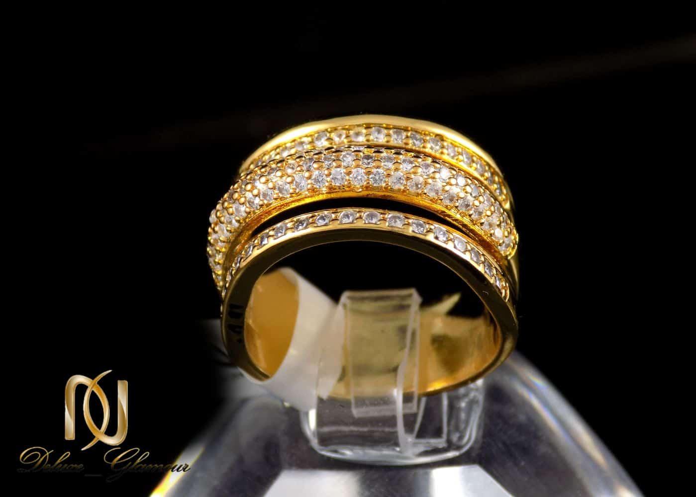 انگشتر زنانه استیل سه رج با روکش آب طلای 18 عیار RG-N173 از نمای مشکی