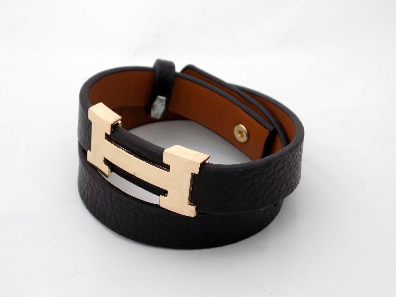 دستبند دخترانه چرمی فری سایز با رویه استیل طلایی ds-n234 از نمای کنار