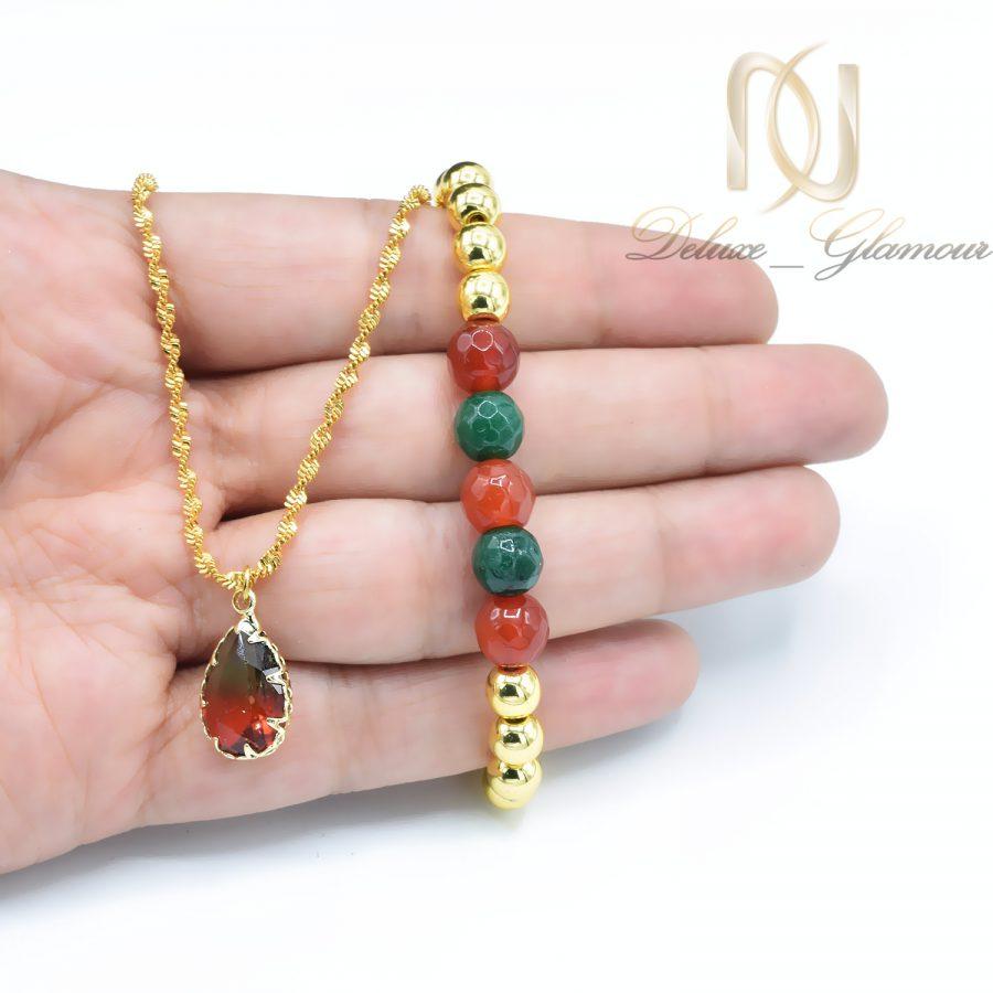 ست دستبند و گردنبند دخترانه سنگی za-n433 از نمای روی دست